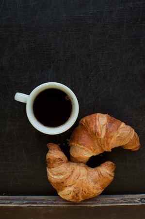 smile coffee with croissant at board photo