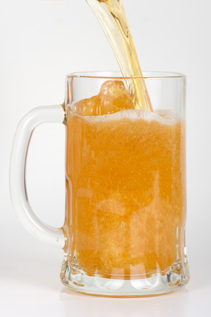 beer is pouring into glass on white background photo