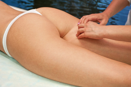 woman buttocks: Legs and buttocks woman massage to reduce cellulite Stock Photo