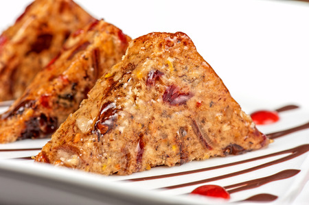 Fruit bread sliced at plate photo