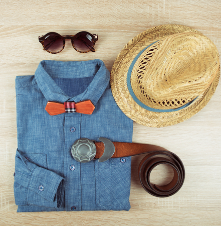 urban style: Top view collection of summer male clothing on the wooden background