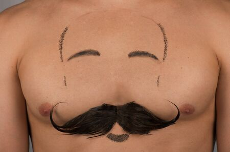 human chest: male torso with moustache and beard at chest