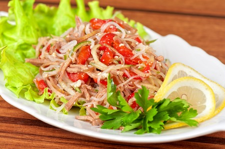 tropical food: Fresh salad with funchozy, meat and vegetables
