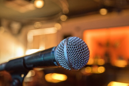 retro microphone: Closeup of audio microphone on stage background Stock Photo