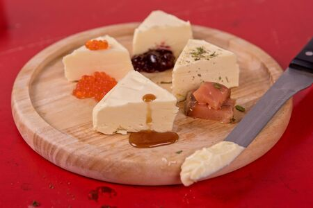 butterfat: fresh butter set with different products as caviar jam salmon fish