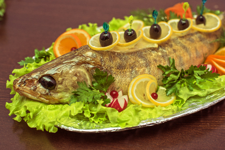 zander: zander fish baked with greens fruits and vegetables Stock Photo