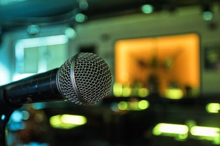 concert background: Closeup of audio microphone on stage background Stock Photo