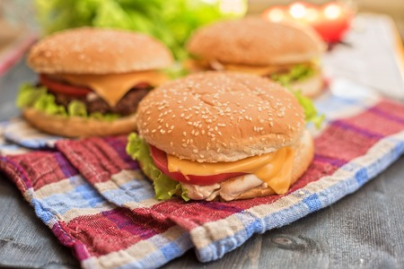burger: Closeup of home made burgers on wooden table