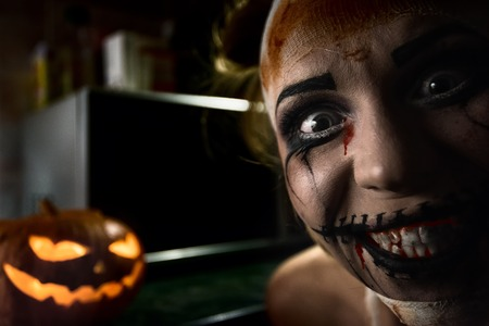pretty eyes: Horrible girl with scary mouth and eyes, halloween theme Stock Photo