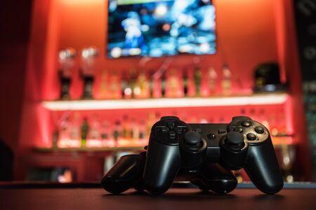 kafe: Video games at bar counter