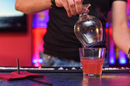 barmen: Closeup photo in a bar where barmen makes cocktail Stock Photo