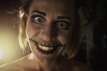 girl on a beautiful background: Horrible girl with scary mouth and eyes Stock Photo
