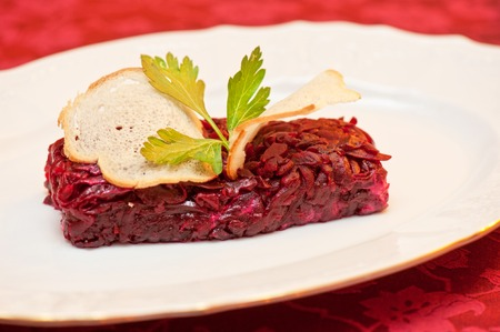 rusk: beet salad with rusk bread at plate Stock Photo
