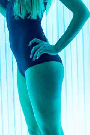 solarium: beautiful girl closeup in swimsuit at solarium