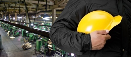 manufacturing materials: Worker with safety helmet at industrial factory