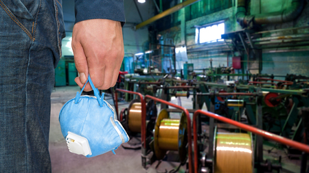 respirator: Worker with protective respirator at man hands at industrial factory