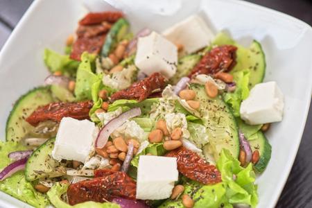 pinoli: Salad feta cheese lettuce sausage cucumbers and pine nuts
