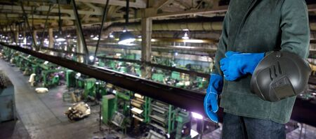 welded: Worker welder with instruments at industrial factory