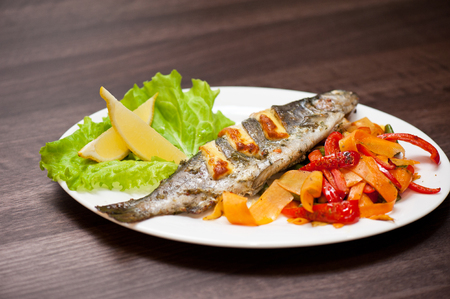 rainbow fish: Tasty dish of rainbow trout fish with vegetables