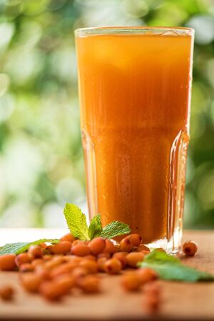fruit non-alcoholic drink with sea buckthorn Stock Photo
