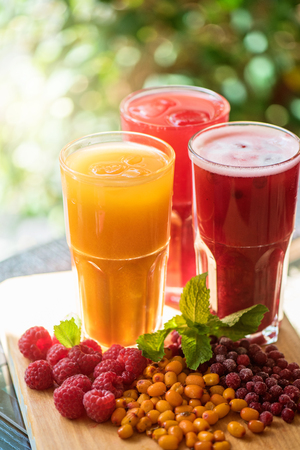 alcoholic beverage: set of fruit non-alcoholic drink with cranberries raspberries and sea buckthorn Stock Photo