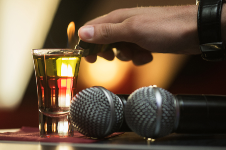 karaoke bar: Closeup photo in a bar where barmen burning drink shot