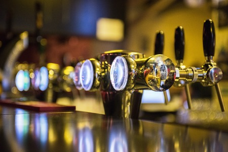 'english: Metallic beer taps, shallow DOF