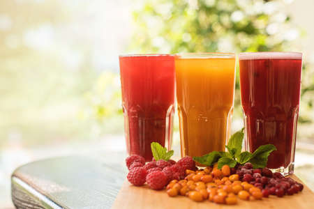 nonalcoholic: set of fruit non-alcoholic drink with cranberries raspberries and sea buckthorn Stock Photo