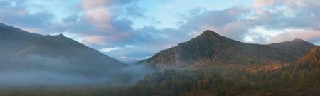 the taiga: sunrise in autumn taiga and mountains