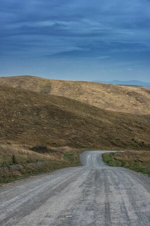 altay: Mountain road in the autumn day in Altay, Siberia, Russia Stock Photo