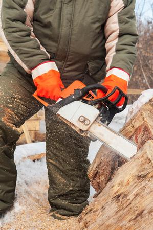 journeyman: Carpenter working at sawmill, closeup photo