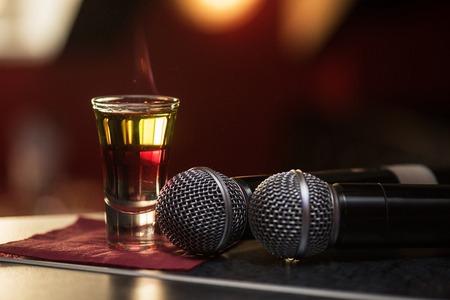 barmen: Closeup photo in a bar where barmen burning drink shot