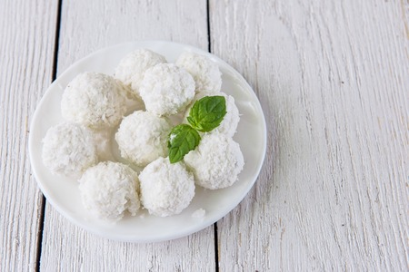 Homemade coconut candies with filling of cream and nut Stock Photo