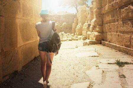 tourist woman at the ruins of ancient city Myra rock at Turkey Demre