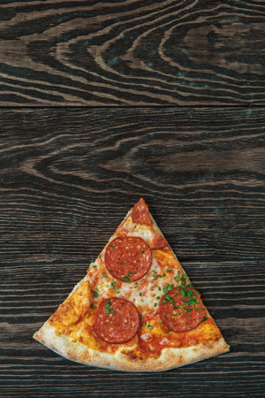 pepperoni: Pepperoni pizza on wooden table