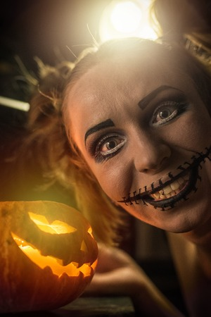 murder scene: Horrible girl with scary mouth and eyes, halloween theme Stock Photo