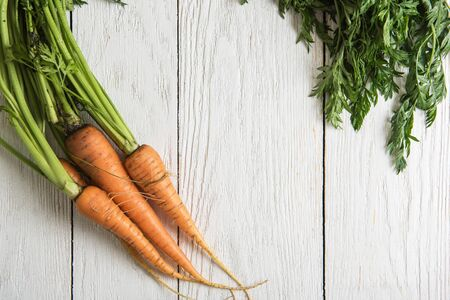 Freshly grown carrots on wooden table Stock Photo