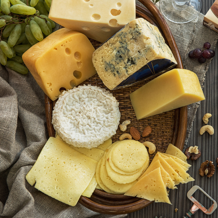 Various types of cheese set with grapes and nuts Stock Photo