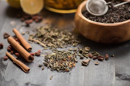 tea composition with cinnamon sticks, lemons and lime