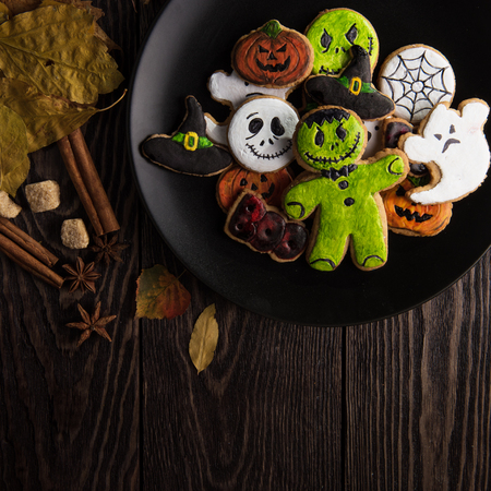 tombstones: Homemade delicious ginger biscuits for Halloween on wooden table