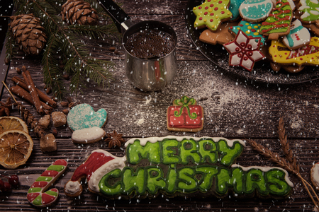 Different ginger cookies and coffee for new years and christmas on wooden background, xmas theme. Top view.