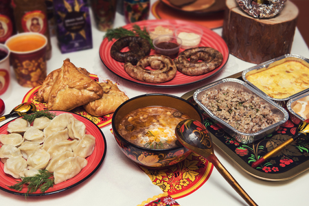 Table with traditional russian food decorated in russian style Stock Photo
