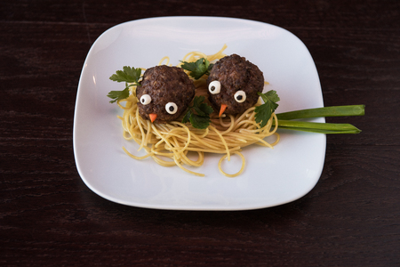 recipe decorated: Funny meatballs with pasta Stock Photo