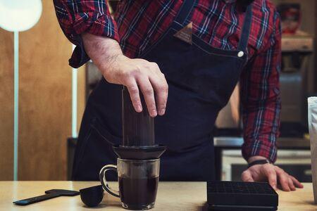 Barista brewing aeropress coffee Stock Photo