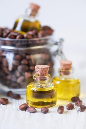 The cedar oil in a glass bottle