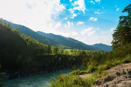 Sunny day in mountain on river Katun