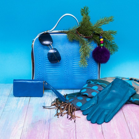 Blue Female accessories on blue background, new year theme Stock Photo