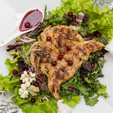 eberesche: quail roasted with sweet and sour cranberry sauce decorated with rowanberry