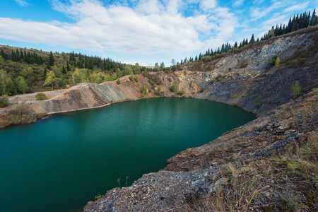 Blue lake in Altai. This is a former copper mine that was flooded with water Stock Photo
