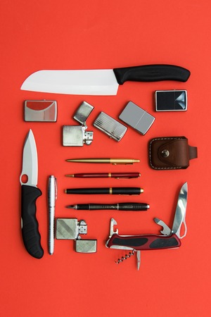 Male gifts on a orange background, flat lay